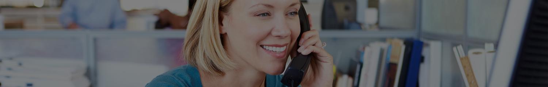 Albuquerque woman using VoIP phone